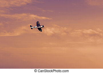 Radio controlled toy airplane at sunset. RC model airplane flying
