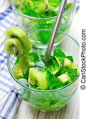 Green Jelly with kiwi fruit slices in a glass.