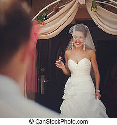 Smiling bride walks out of the house