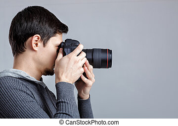 profile portrait of successful professional photographer use...