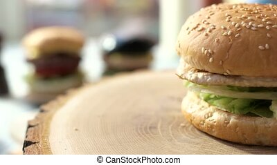 Burger on a wood board. Sesame bun and meat. Simplest recipe...
