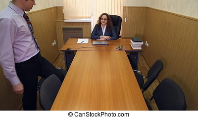 Meeting in the office of the director, the headmistress with...