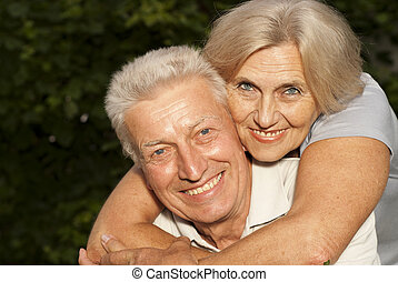 Beautiful aged couple in the park - Beautiful elderly couple...