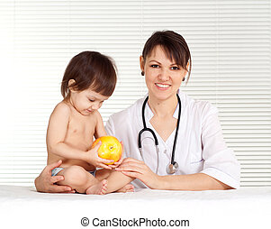 Doctor with girl - Doctor pediatrician with a young girl in...