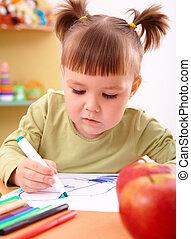 Little girl draws with felt-tip pen
