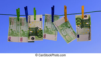 Money laundering - 100 euro banknotes hung on a washing...
