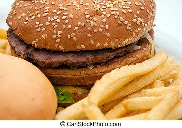 Junk food - A tasty hamburger, cheeseburger and french fries...