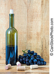 Fresh grape and red wine on the vintage table, selective focus