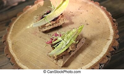 Top view of two sandwiches. Lettuce and bacon jam.
