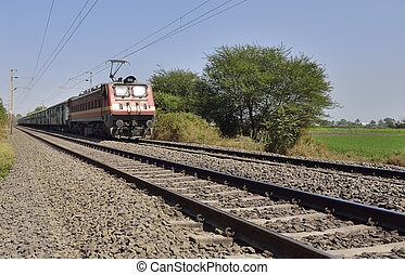 Indian Long Distance Train Approaching Station - Indian...
