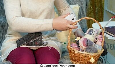 Girl photographs needlework on a smartphone - Woman enjoys...