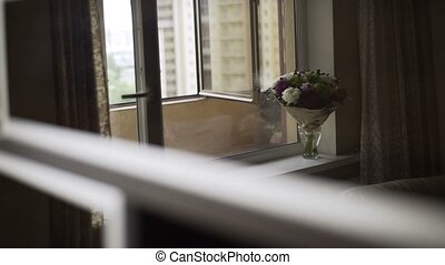 Flowers bouquet in room near window