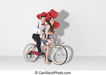 Young couple riding on the bike