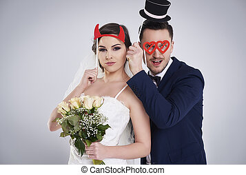 Young marriage with funny accessories
