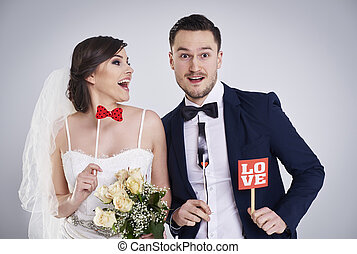 Close up of playful bride and bridegroom