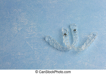 Clear Invisible Teeth Aligner on a blue background