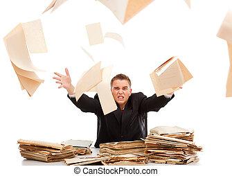 Man throwing away paperwork