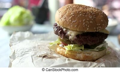 Close-up of a beef burger. Grilled meat, cheese and...