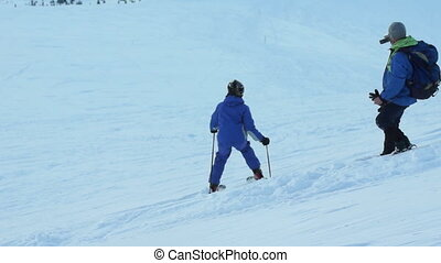 Ski snow shot camera - Photographing winter with snowfall on...