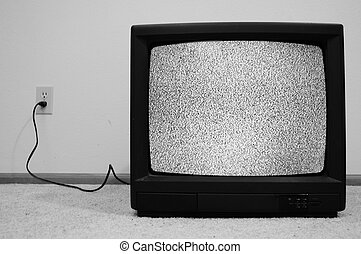 Television plugged into wall with static - An old CRT TV...