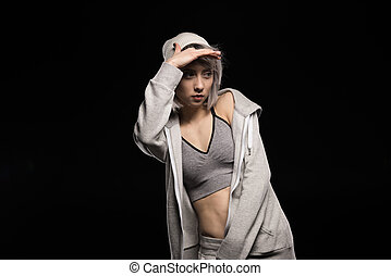 portrait of woman in sports clothing on black