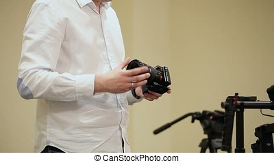 Man demonstrating mirrorless camera in class