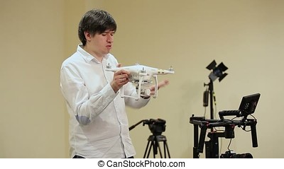Man demonstrating drone quadcopter in class