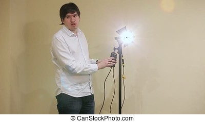 Man demonstrating light unit device in class