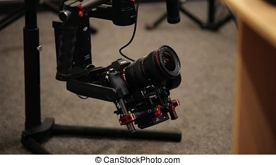 Electronic steadicam with camera indoors