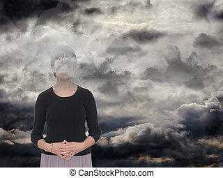 Woman with grey clouds. Depression,sadness concept. - With...