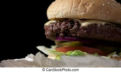 Close-up of burger. Piece of grilled meat. Incredible taste...