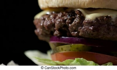 Close-up of hamburger. Grilled meat and vegetable slices.