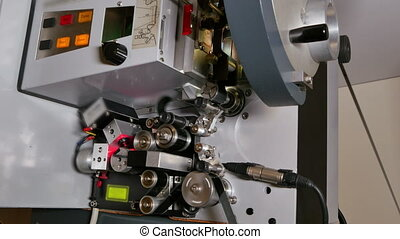 Film Projector Projecting 35mm Movie - A technician projects...