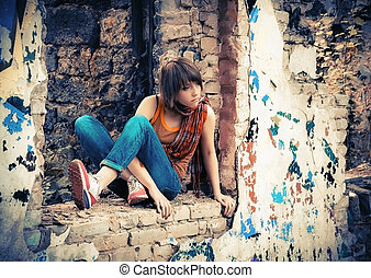 Young Woman In The Ruins With Graffiti
