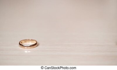 Wedding rings rolls one to another - Wedding golden rings...