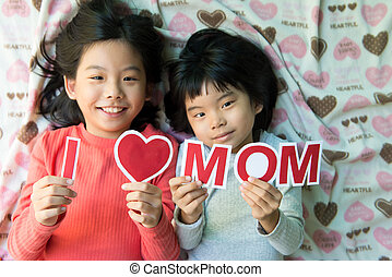 Happy Mother's Day - Two Asian kids holding I Love Mom...