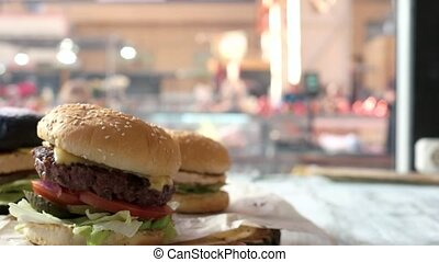 Side view of tasty burgers. Sesame bun cheeseburger. Best...