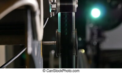 Film Projector Closeup with Projection Screen on the Back -...