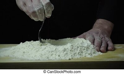 Super slow motion chef kneads the dough - Super slow motion...