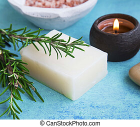 Herbal spa with rosemary soap, candle and herb