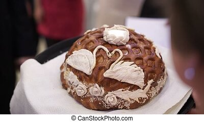 Breaking wedding bread at party