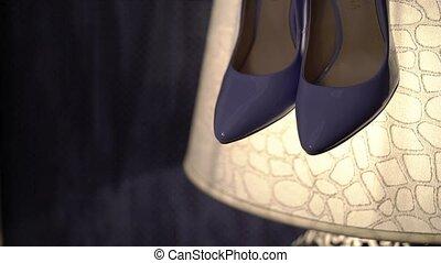 Violet woman's shoes on lamp closeup