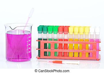 Set of chemical test tubes, syringe and beaker with permanganate