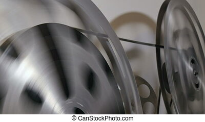 35mm Film Cinema Reel Rewinding - A technician rewinds 35mm...