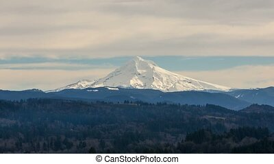 Time lapse of clouds over snow covered Mt Hood from Jonsrud...
