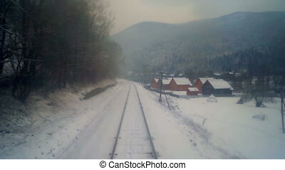 Village train move forest mountains