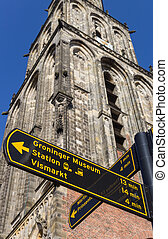 Tourist sign in front of the Martini tower in Groningen,...