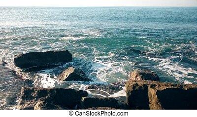 Waves on the coast rocks.