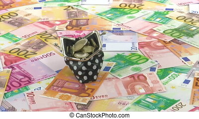 Living costs - Purse filled with euro coins rotating on Euro...