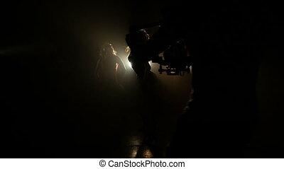 Videographer take video dancing girls - Video cameraman...